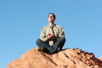 business man meditating