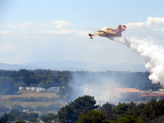 canadair dropping water
