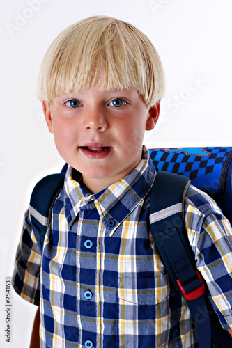 young child with a backpack
