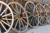 a row of old wagon wheels