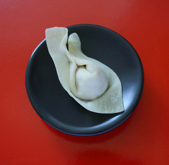 wonton in a black dish