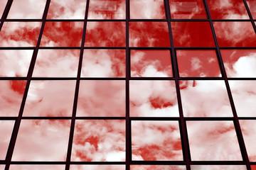 fenetres d' immeuble de bureaux ciel rouge