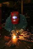 welder grinding metal poster