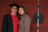 graduate and his wife on ceremony day. poster
