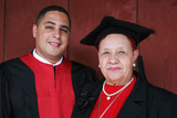 university graduate in robes with his grandmother. poster