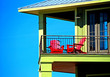 red chairs on balcony