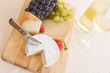 composition of white wine, grapes and cheese