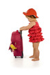 baby girl in red dress with a purple bag