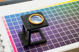table of colour with magnifier lens poster