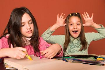 girl drawing and cheeky girl