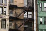 three buildings and a fire escape poster