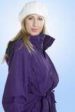 woman in warm winter jacket poster