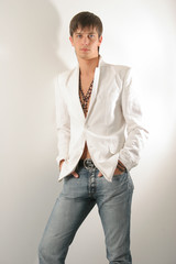 man in a white jacket and jeans