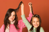 two pretty girls touching hair poster