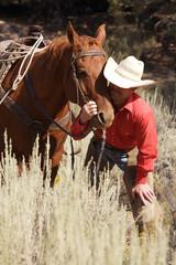 cowboy loving his horse