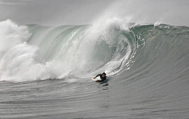 bodyboarder and wave