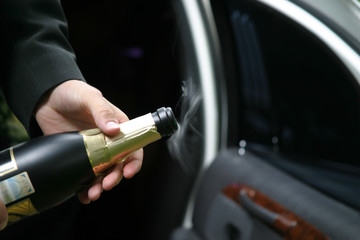 opening of a bottle with a sparkling wine