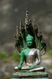 statue of emerald buddah - shallow focus poster