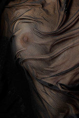 beautifull firm breast covered by material.