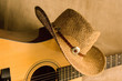 country guitar and hat
