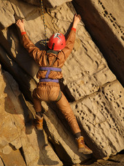 climber on the yellow red volcanic rock