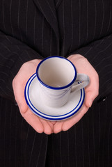 open hands of a business woman with coffee