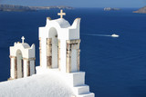 a greek orthodox church in oia with sea backgroun poster