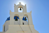 a greek orthodox church in oia, santorini. poster