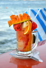fruit salad cocktail with sea background
