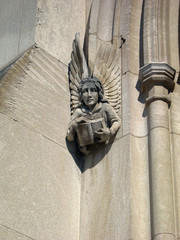 stone angel with book
