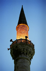 minaret on the  mosque by night