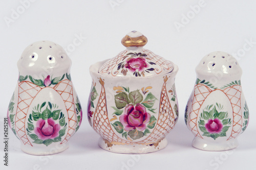 two saltshakers and  mustard-pot