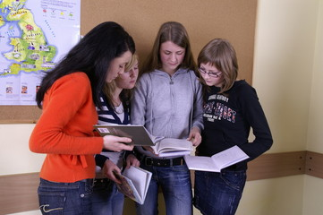 a group of students discussing their work