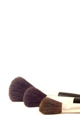 three make-up brushes