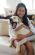 asian girl with her yawning dog