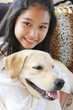 smiling asian girl with her pet dog