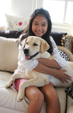 happy asian girl with her pet dog