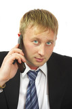 the businessman speaks by phone. conducts conversation. poster