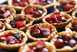 tasty puff pastry baskets full of colorful berries