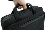 hand carrying business suitcase - isolated poster