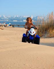 woman on motobike on the beach