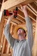 construction man using drill