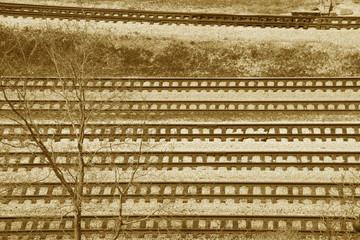 multiple railroad tracks in sepia