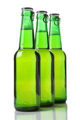 three green beer bottles