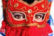 closeup of beautiful woman wearing fancy red mardi gras mask wit