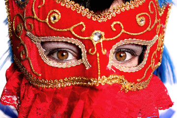 closeup of beautiful woman wearing fancy red mardi gras mask wit