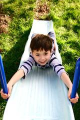 a young boy enjoying the outdoors