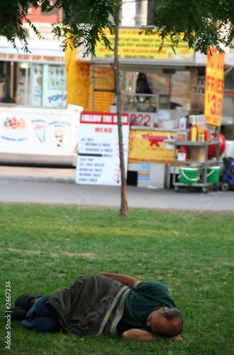 homeless man sleeping in park