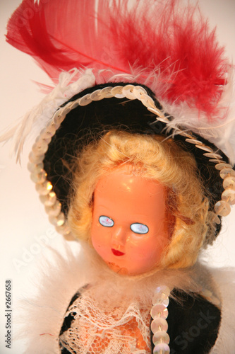 crazy scary doll with blue eyes and a black and re