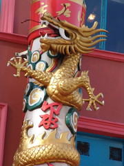 golden chinese  dragon on pillar